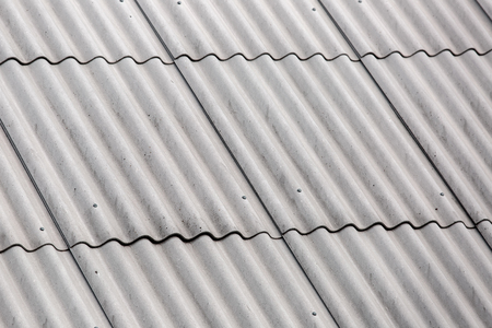 71570356 - roofing felt asbestos, overlapping roof close up.